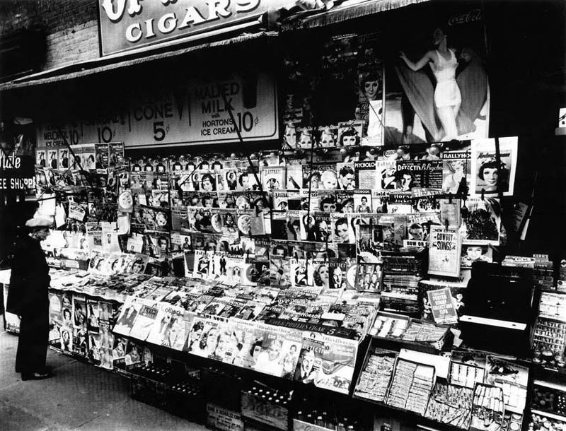 Western, detective and horror pulp magazines were prominently displayed in the most accessible area of this newsstand in 1935